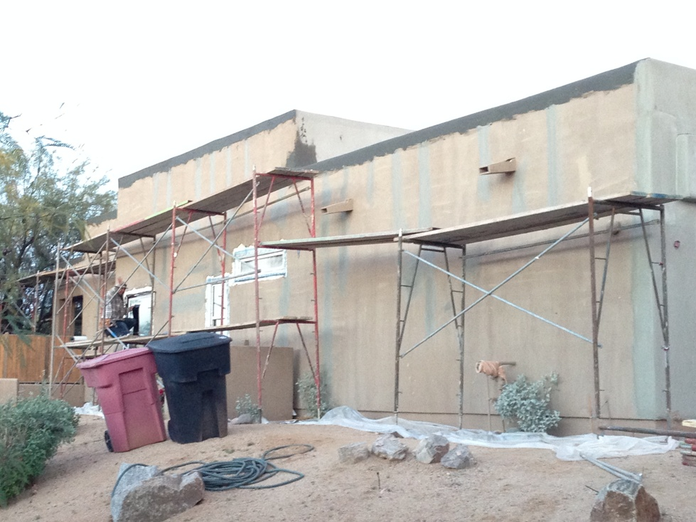Custom home in North Scottsdale full renovation and re-coat. We opened and repaired dozens of cracks around the home, opened and repaired many leaky parapets with water intrusion, and also pulled and repaired leaky windows with water intrusion issues as well. We then covered the entire house in a reinforcing mesh to stop the cracks from reappearing, and then finally finished the home with a integrally colored synthetic finish.
